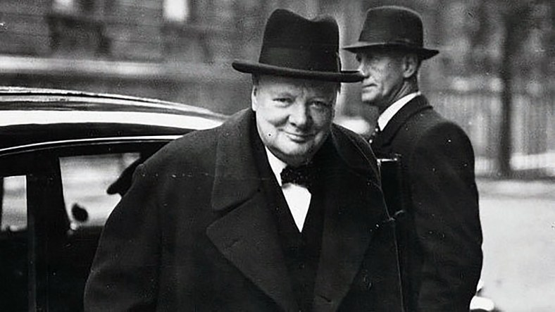 Winston Churchill coming out of a car black and white photo